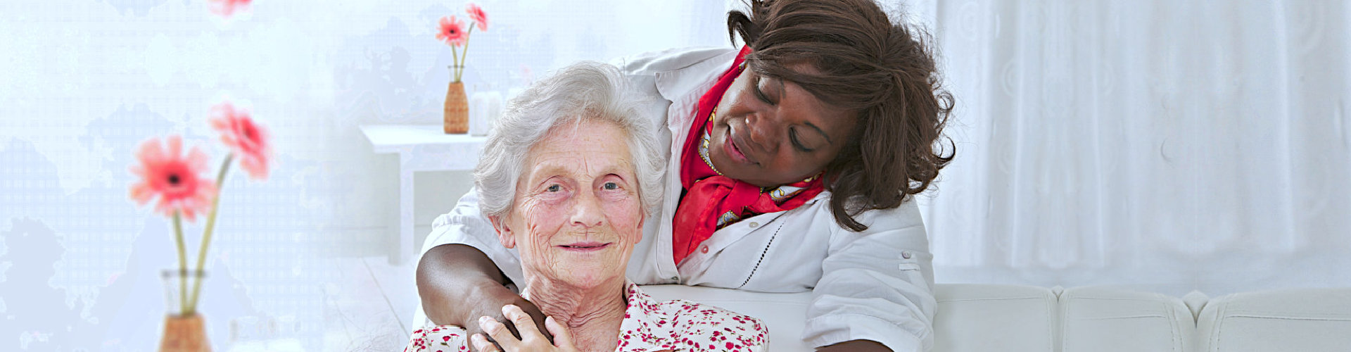 old woman smiling with her caregiver
