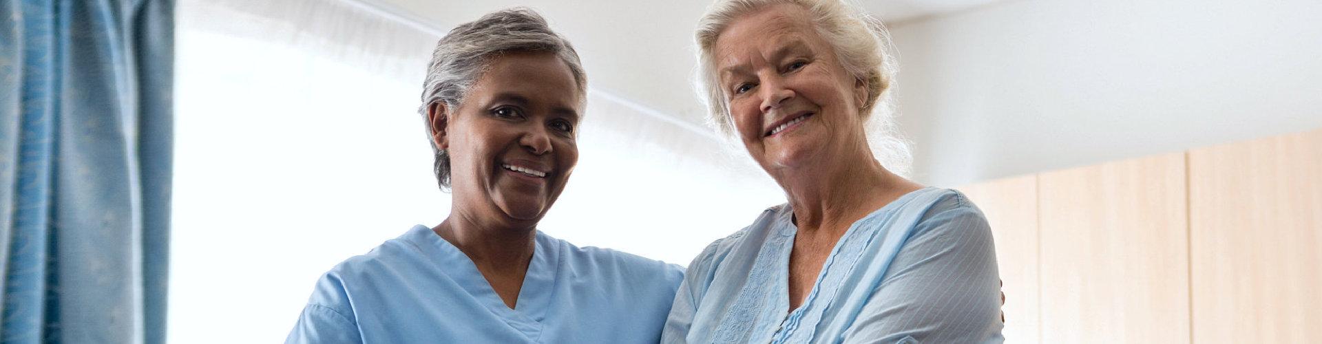 two ladies smiling